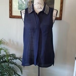 Sleeveless, sheer navy blouse w/ metal collar